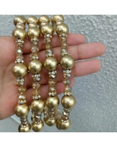 Tiara dourada com cristal